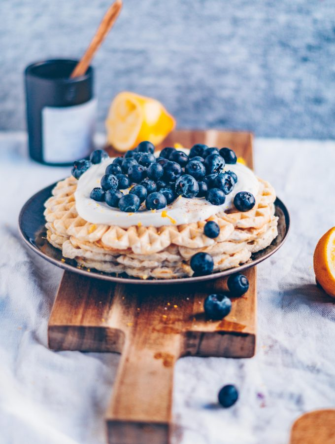 Lemon Waffles with yogurt frosting and blueberries